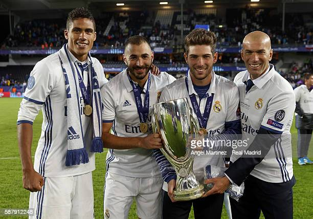 Raphael Varane Karim Benzema Luca Zidane and head coach Zinedine Zidane of Real Madrid pose with the trophy after the UEFA Super Cup match between...
