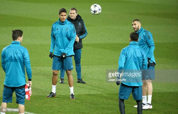 Raphael Varane Karim Benzema of Real Madrid during Real Madrid's training on the eve of UEFA Champions League match between Paris Saint Germain and...