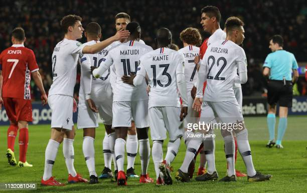 Raphael Varane of France celebrate his goal with teammattes during the 2020 UEFA European Championships Group H qualifying match between Moldova and...