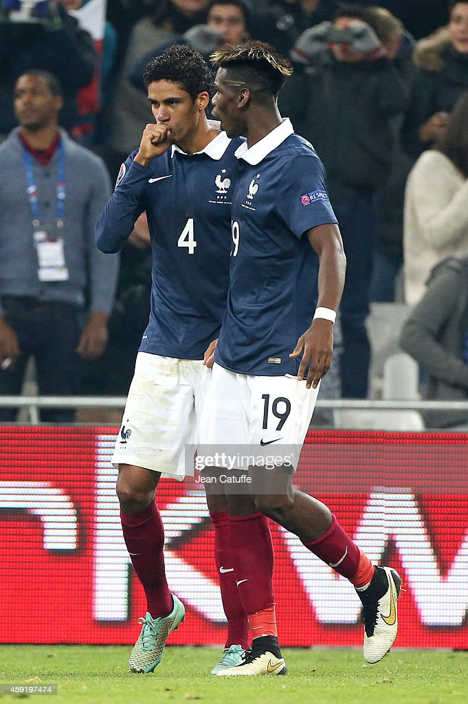 Raphael Varane of France celebrates scoring a goal for his team with teammate Paul Pogba during the international friendly match between France and Sweden at the Stade Velodrome on November 18, 2014 in Marseille, France.