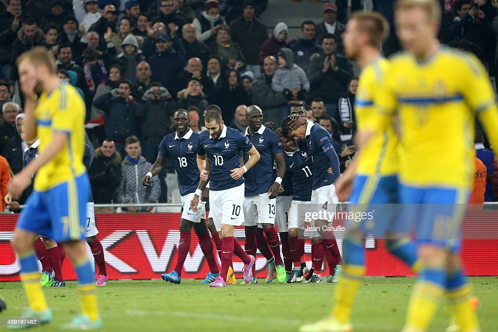 Raphael Varane of France (R) celebrates scoring a goal for his team with teammates during the international friendly match between France and Sweden at the Stade Velodrome on November 18, 2014 in Marseille, France.