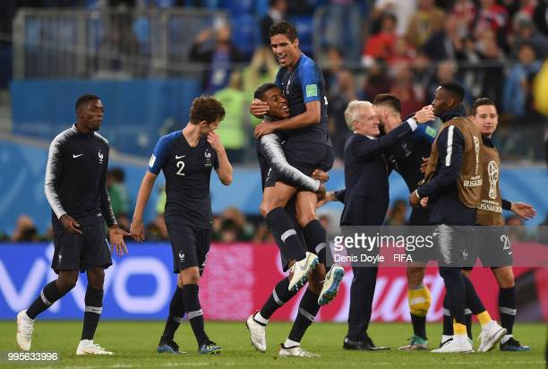 Raphael Varane of France celebrates with a teammate after France beat Belgium 10 in the 2018 FIFA World Cup Russia Semi Final match between Belgium...