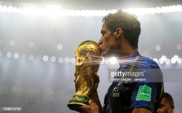 Raphael Varane of France celebrates with the World Cup Trophy following his sides victory in the 2018 FIFA World Cup between France and Croatia at...