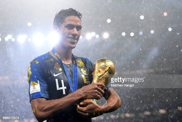 Raphael Varane of France celebrates with the World Cup Trophy following his sides victory in the 2018 FIFA World Cup Final between France and Croatia...