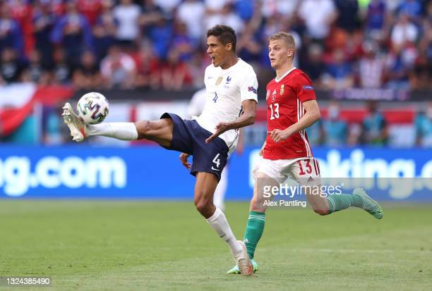 Raphael Varane of France controls the ball whilst under pressure from Andras Schaefer of Hungary during the UEFA Euro 2020 Championship Group F match...