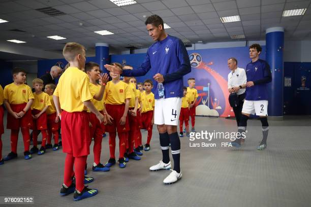 Raphael Varane of France greets the mascots in the tunnel prior to the 2018 FIFA World Cup Russia group C match between France and Australia at Kazan...