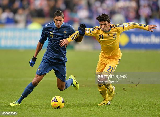Raphael Varane of France in action against De Lacerda Edmar of Ukraine during the FIFA World Cup 2014 qualifying football match between France vs...