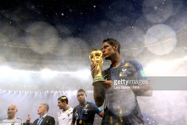 Raphael Varane of France kisses the World Cup trophy following the 2018 FIFA World Cup Final between France and Croatia at Luzhniki Stadium on July...