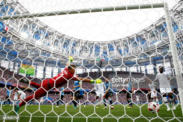 Raphael Varane of France scores his sides first goal past Fernando Muslera of Uruguay during the 2018 FIFA World Cup Russia Quarter Final match...