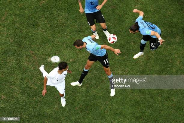 Raphael Varane of France scores his team's first goal during the 2018 FIFA World Cup Russia Quarter Final match between Uruguay and France at Nizhny...