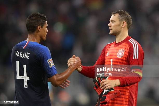 Raphael Varane of France speaks with Manuel Neuer of Germany after the UEFA Nations League Group A match between Germany and France at Allianz Arena...