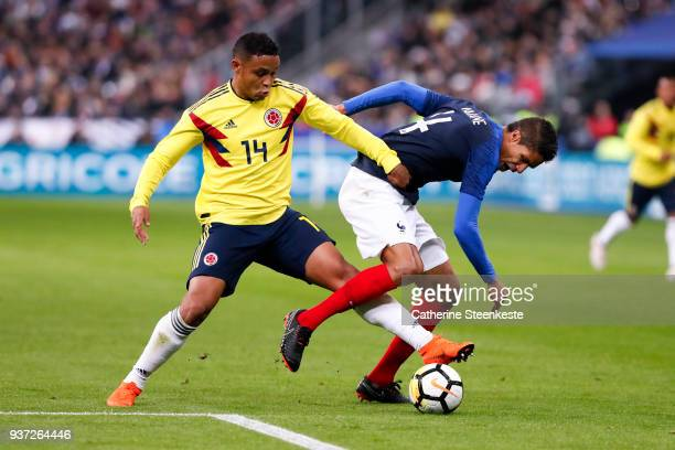 Raphael Varane of France tries to control the ball against Luis Fernando Muriel of Colombia during the international friendly match between France...