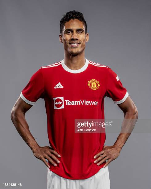 Raphael Varane of Manchester United poses after signing for the club at Carrington Training Ground on August 16, 2021 in Manchester, England.
