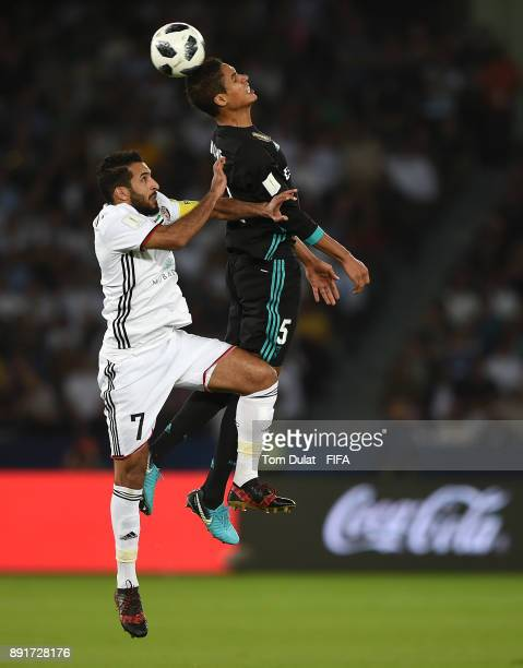 Raphael Varane of Real Madrid and Ali Mabkhout of Al Jazira jump to the ball during the FIFA Club World Cup UAE 2017 semi final match between Al...