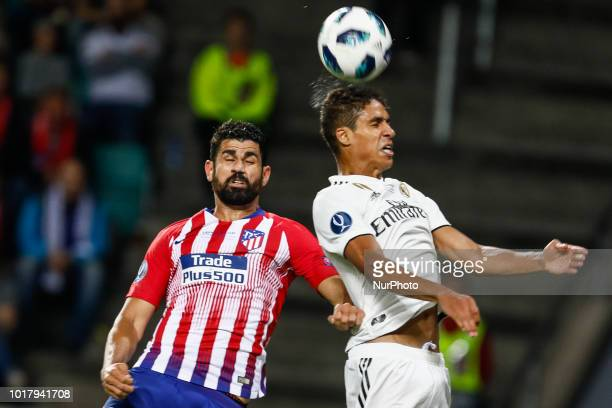 Raphael Varane of Real Madrid and Diego Costa of Atletico Madrid vie for a header during the UEFA Super Cup match between Real Madrid and Atletico...