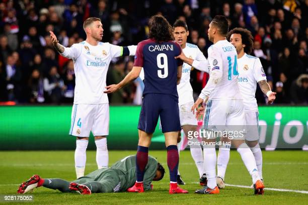 Raphael Varane of Real Madrid and Edinson Cavani of Paris SaintGermain argue during the UEFA Champions League Round of 16 Second Leg match between...