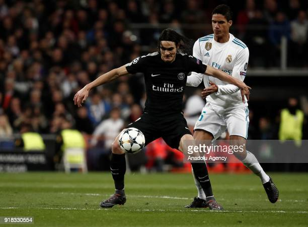 Raphael Varane of Real Madrid and Edinson Cavani of Paris SaintGermain vie for the ball during the UEFA Champions League Round of 16 football match...
