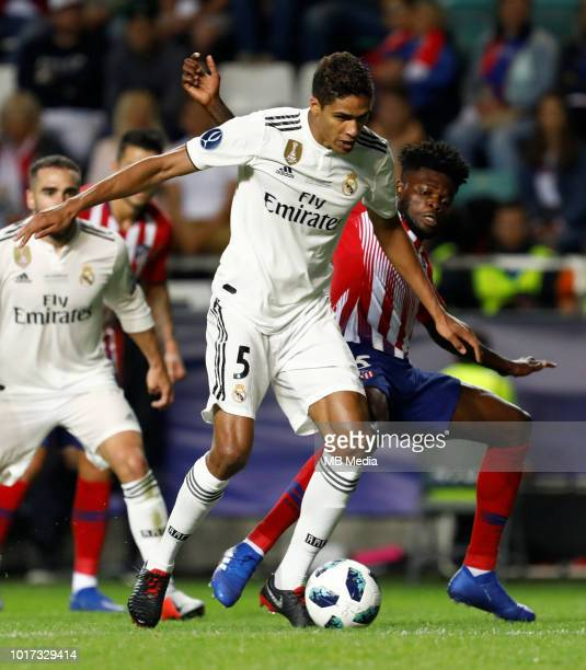 Raphael Varane of Real Madrid and Thomas Partey of Atletico Madrid vie for the ball during the UEFA Super Cup match between Real Madrid and Atletico...