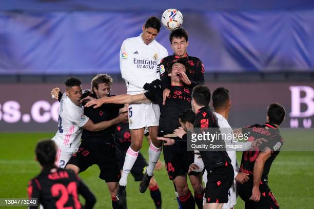 Raphael Varane of Real Madrid battle for the ball with Zubimendi of Real Sociedad during the La Liga Santander match between Real Madrid and Real...