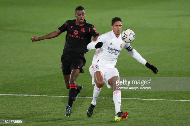 Raphael Varane of Real Madrid battles for possession with Alexander Isak of Real Sociedad during the La Liga Santander match between Real Madrid and...