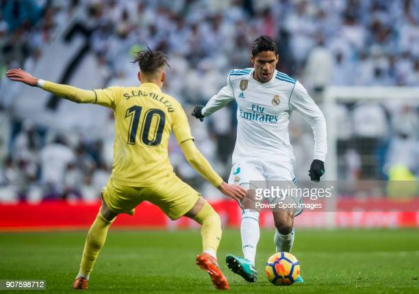 Raphael Varane of Real Madrid battles for the ball with Samuel Castillejo Azuaga Samu Castillejo of Villarreal CF during the La Liga 201718 match...