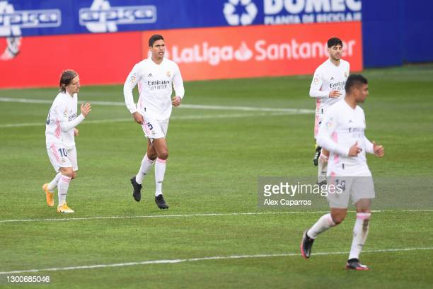 Raphael Varane of Real Madrid celebrates after scoring his team's first goal during the La Liga Santander match between SD Huesca and Real Madrid at...