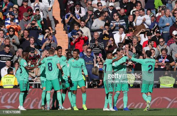 Raphael Varane of Real Madrid celebrates with his team mates after scoring his team's first goal during the Liga match between Real Madrid CF and RCD...