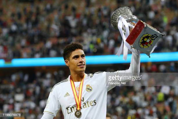 Raphael Varane of Real Madrid celebrates with the trophy after his teams victory in the Supercopa de Espana Final match between Real Madrid and Club...