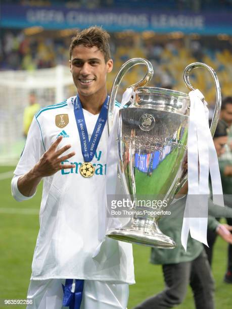 Raphael Varane of Real Madrid celebrates with the trophy after the UEFA Champions League Final between Real Madrid and Liverpool at NSC Olimpiyskiy...