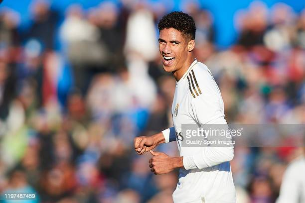 Raphael Varane of Real Madrid CF celebrates scoring his team's opening goal during the Liga match between Getafe CF and Real Madrid CF at Coliseum...