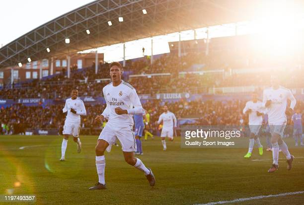 Raphael Varane of Real Madrid CF celebrates scoring his team's second goal during the Liga match between Getafe CF and Real Madrid CF at Coliseum...