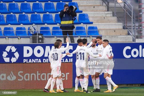 Raphael Varane of Real Madrid CF celebrates with teammates after scoring his team's second goal during the La Liga Santander match between SD Huesca...