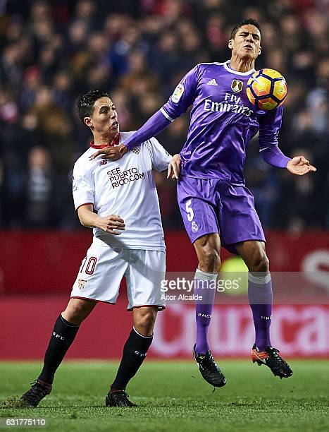 Raphael Varane of Real Madrid CF competes for the ball with Samir Nasri of Sevilla FC during the La Liga match between Sevilla FC and Real Madrid CF...