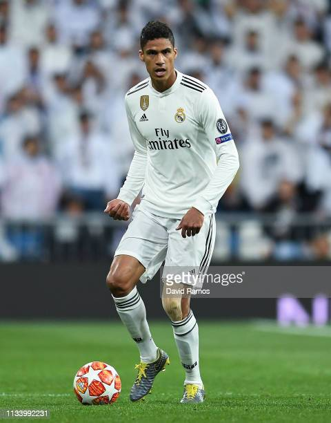 Raphael Varane of Real Madrid CF runs with the ball during the UEFA Champions League Round of 16 Second Leg match between Real Madrid and Ajax at...