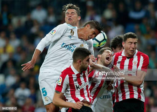 Raphael Varane of Real Madrid CF wins the header after Inigo Martinez of Athletic Club during the La Liga match between Real Madrid CF and Athletic...