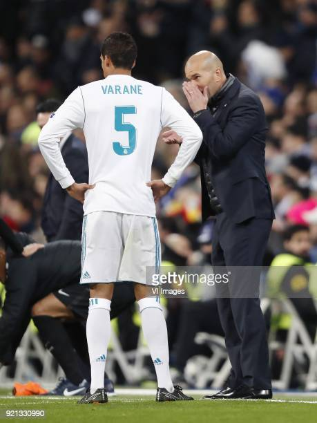 Raphael Varane of Real Madrid coach Zinedine Zidane of Real Madrid during the UEFA Champions League round of 16 match between Real Madrid and Paris...