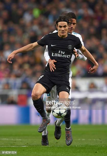 Raphael Varane of Real Madrid competes for the ball with Edinson Cavani of Paris SaintGermain during the UEFA Champions League Round of 16 First Leg...