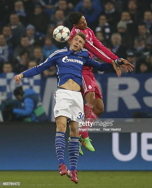 Raphael Varane of Real Madrid competes for the ball with Felix Platte of FC Schalke 04 during the UEFA Champions League Round of 16 first leg match...