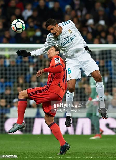 Raphael Varane of Real Madrid competes for the ball with Mikel Oyarzabal of Real Sociedad during the La Liga match between Real Madrid and Real...
