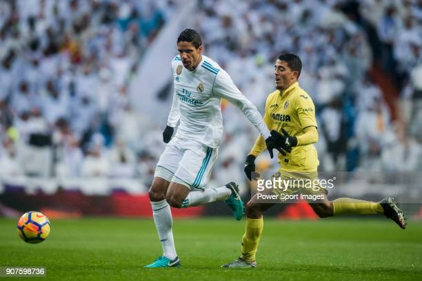 Raphael Varane of Real Madrid competes for the ball with Pablo Fornals of Villarreal CF during the La Liga 201718 match between Real Madrid and...