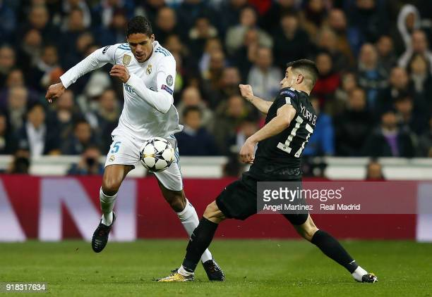 Raphael Varane of Real Madrid competes for the ball with Yuri Bereiche of Paris SaintGermain during the UEFA Champions League Round of 16 First Leg...