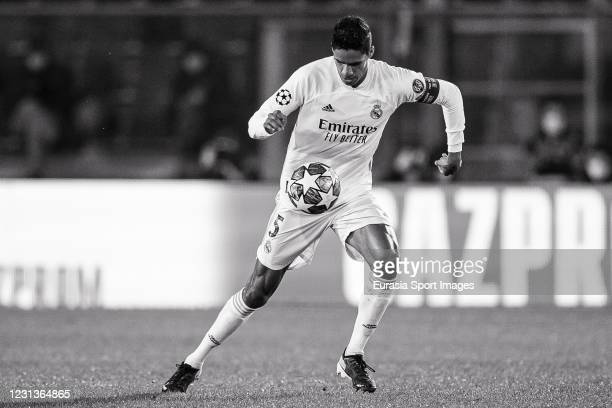 Raphael Varane of Real Madrid controls the ball during the UEFA Champions League Round of 16 match between Atalanta and Real Madrid at Gewiss Stadium...