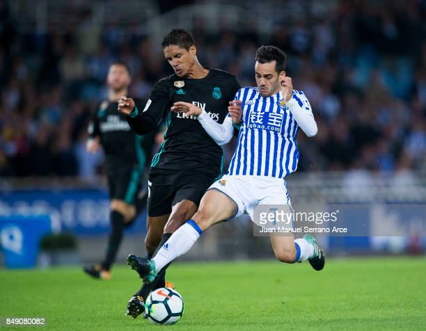 Raphael Varane of Real Madrid duels for the ball with Juan Miguel Jimenez 'Juanmi' of Real Sociedad during the La Liga match between Real Sociedad de...