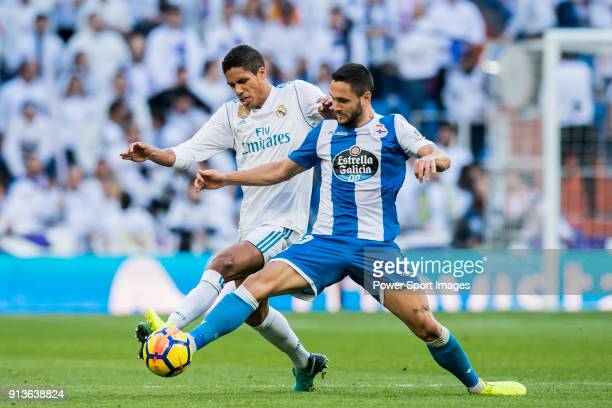 Raphael Varane of Real Madrid fights for the ball with Florin Andone of RC Deportivo La Coruna during the La Liga 201718 match between Real Madrid...