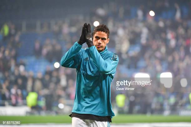 Raphael Varane of Real Madrid greets the fans before the Champions League match between Real Madrid and Paris Saint Germain at Estadio Santiago...