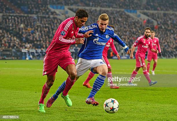 Raphael Varane of Real Madrid holds off the challenge from Felix Platte of Schalke during the UEFA Champions League Round of 16 match between FC...