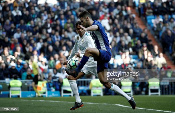 Raphael Varane of Real Madrid in action against Alfonso Pedraza of Deportivo Alaves during the La Liga soccer match between Real Madrid and Deportivo...