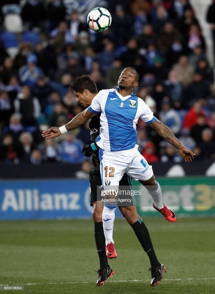 Raphael Varane of Real Madrid in action against Claudio Beauvue of Leganes during the La Liga football match between Leganes and Real Madrid at the Estadio Municipal Butarque in Madrid, Spain on February 21, 2018.