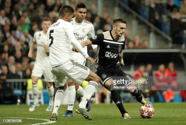 Raphael Varane of Real Madrid in action against Dusan Tadic of Ajax during UEFA Champions League Round of 16 second leg match between Real Madrid and...