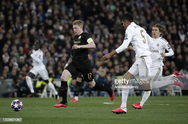 Raphael Varane of Real Madrid in action against Kevin de Bruyne of Manchester City during the UEFA Champions League round of 16 first leg soccer...